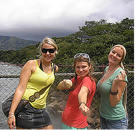 Girls on their way to the hot springs on the bridge over the Caldera River
